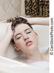bathing woman in bathtub
