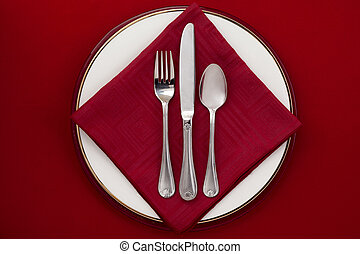 fork knife and spoon - Fork, knife and spoon on a plate with...