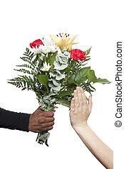 female hands refusing flowers - Female hand refusing the...
