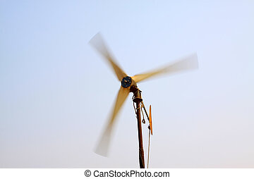 rotating wind turbine in blue sky