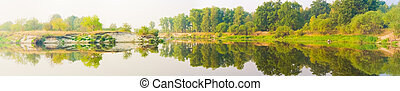 Wide panorama of a river and the forest