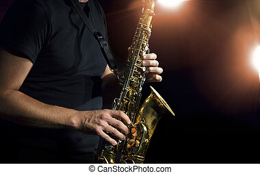 Sax - Musician playing alto saxophone on a gig.