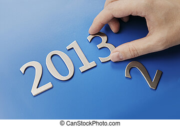 A Brand New Year - Man changing metallic numbers to year...