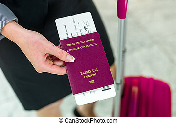businesswoman with passport, luggage and flight ticket at...