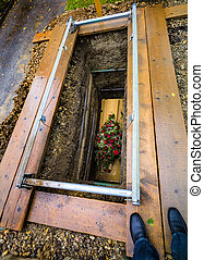 fresh grave - the open coffin with fresh grave in a cemetery...