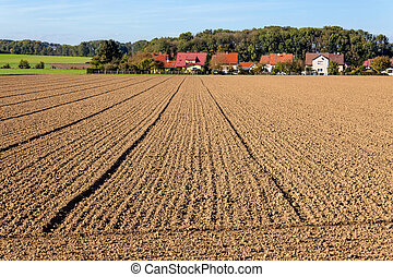 field of a farmer - the freshly tilled fields of the farmers...