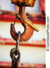 crane hook - the hook of a crane at a construction site when...