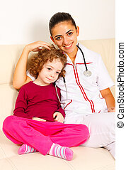 Caring padiatrician with little girl - Smiling doctor...