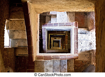 Torre del Mangia stairs - Looking down the stairs in the...