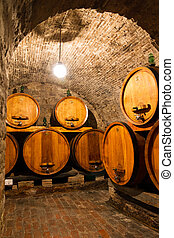 Wine cellar arch - Big wooden barrels of wine in a...