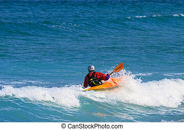 Man paddling a Sea kayak - Man in a white water single kayak...