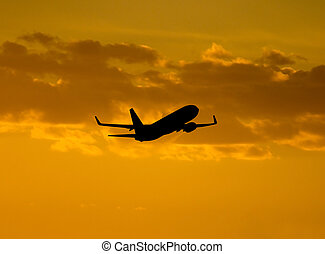 Aircraft takeoff - Silhouette of a aircraft after takeoff.