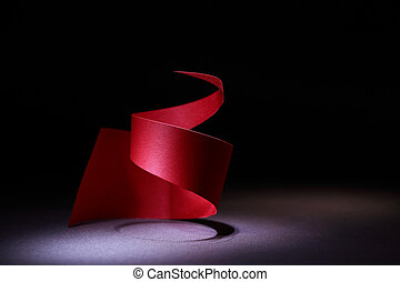 Red Spiral - Abstract composition with red paper spiral on...