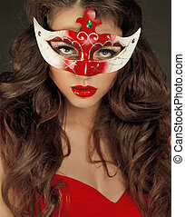 Beautiful Girl in Carnival mask with long curly hair...