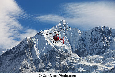 helicopter in snow mountain range