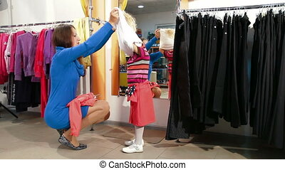 Family Shopping - Mother and little daughter shopping for...