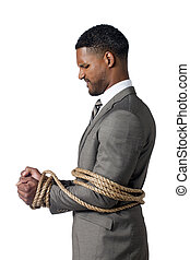 frowning businessman - Frowning businessman tied up with...
