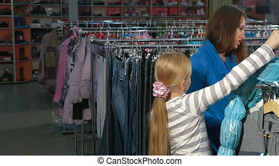 Clothing Store - Mother and daughter choosing clothes in a...