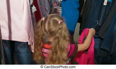 Little Girl Shopping Clothes