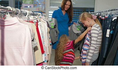 Clothes Shopping Fun - Mother with two daughters shopping...