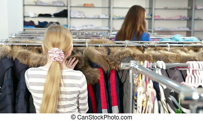 Clothing Store - Mother and daughter shopping for girls...
