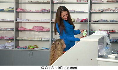 Shopping for Children's Clothes - Mother and little daughter...