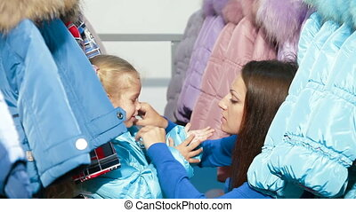 Shopping For Winter Clothes - Mother and daughter shopping...