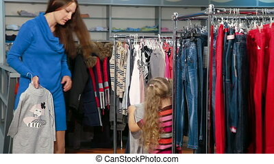 Family Shopping - Mother and daughter shopping for girls...