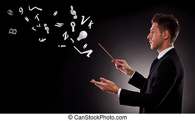 business man directing lots of symbols - Side view of a...