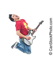 jumping guitarist shouting - young man jumping and shouting...