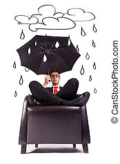 man sitting in comfortable armchair with umbrella - Image of...