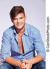 relaxed fashion male model wearing teeth braces looking and...
