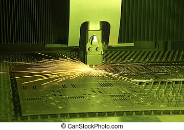 laser cutter - Industrial laser cutter with green...