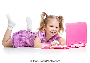 child girl playing with laptop toy