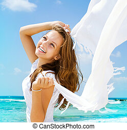 Beautiful Girl With White Scarf on The Beach Travel and...