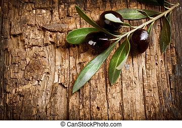 Olives over Old Wood Background