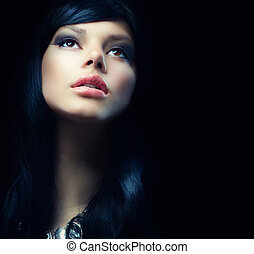 Beautiful Brunette Girl over Black Background Darkness