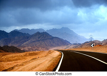 The road in the mountainous desert of the Sinai Peninsula