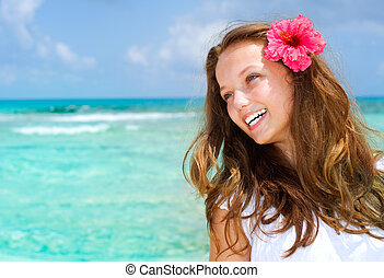 Beautiful Girl in Tropical Resort. Travel and Vacation...