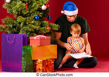 creating wish list - baby with her father are creating wish...