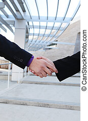 Business deal handshake - A man and woman handshake to...