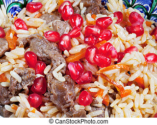 background from asian pilau with pomegranate seeds and meat...