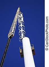 Assembilig cell tower with the crane - installation of the...