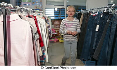 Clothes Shopping - Mother and daughter choosing clothes in a...