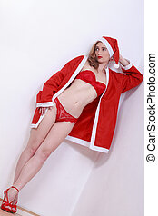 Sexy woman in Christmas costume - Young woman in red...