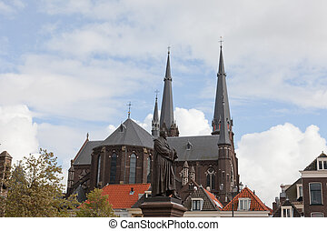 Old church in Delft, Holland, against the blue sky