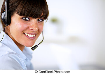 Hispanic young woman wearing headphone looking and smiling...