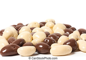 almonds in chocolate over white background