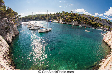 Calanques with sailingboats - Calanques bay with azure blue...