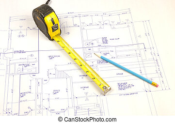Building plans and tape measure